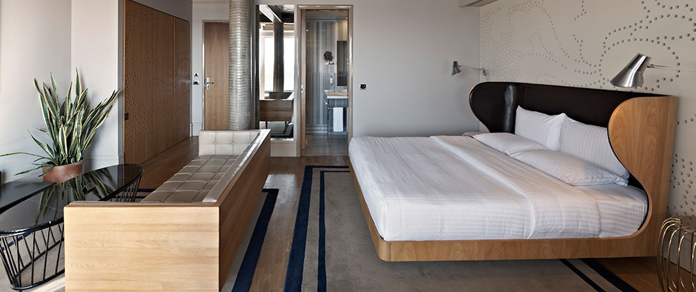 Bed and living room of King Panoramic with Terrace room at Witt Istanbul Hotel.