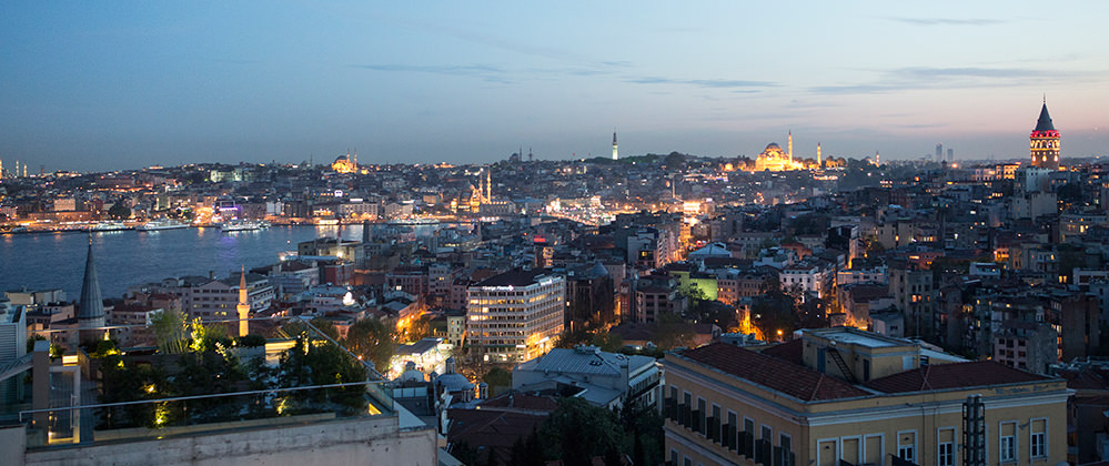 Witt Istanbul hotel roof garden with city view by night